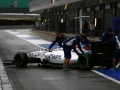 Silverstone, Northamptonshire, UK.Tuesday 12 July 2016.Alex Lynn, Williams FW38 Mercedes, is wheeled back in the pit lane by mechanics.Photo: Zak Mauger/Wiliams F1ref: Digital Image _79P0267